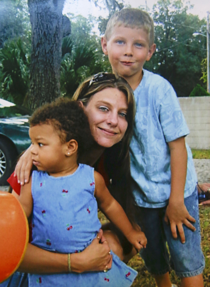 Tracy Veira, shown with her children in 2009, was detoxing from painkillers in a Florida jail when she fell ill and saw a nurse, but was sent back to her cell – and choked to death.