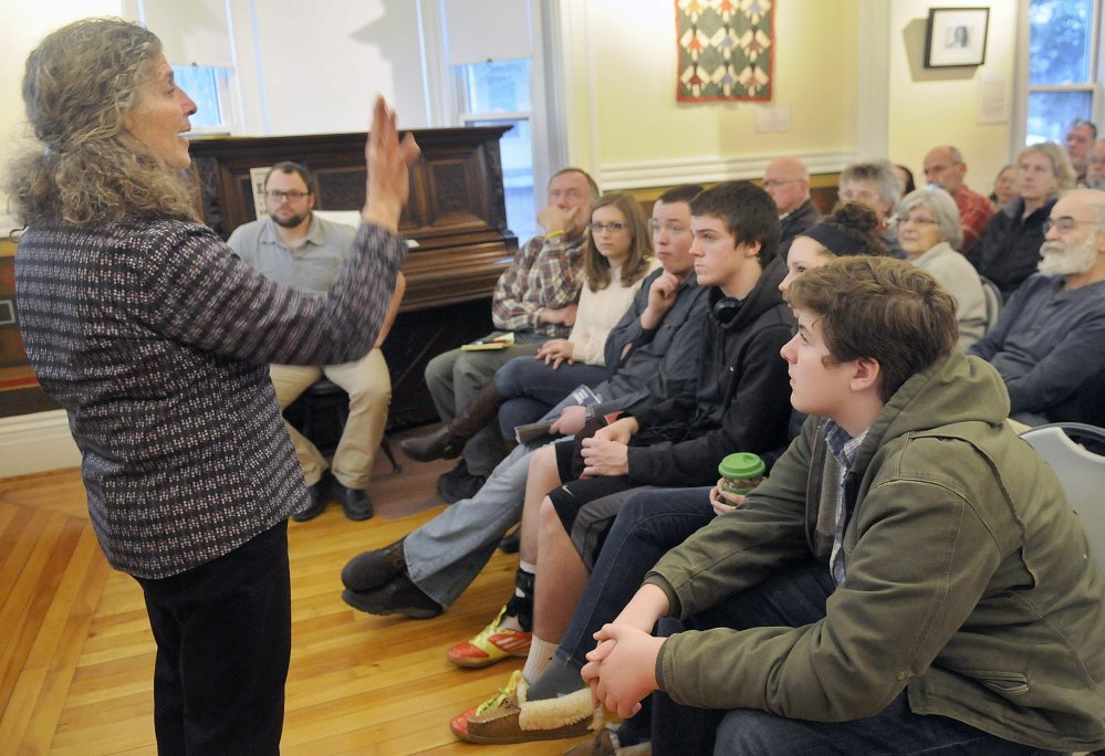 Candace Kanes, curator of the Maine Historical Society's Maine Memory Network, discusses the hundreds of former slaves who came to Maine in the last years of the Civil War, during a Martin Luther King Day talk at the Southard House Museum in Richmond.