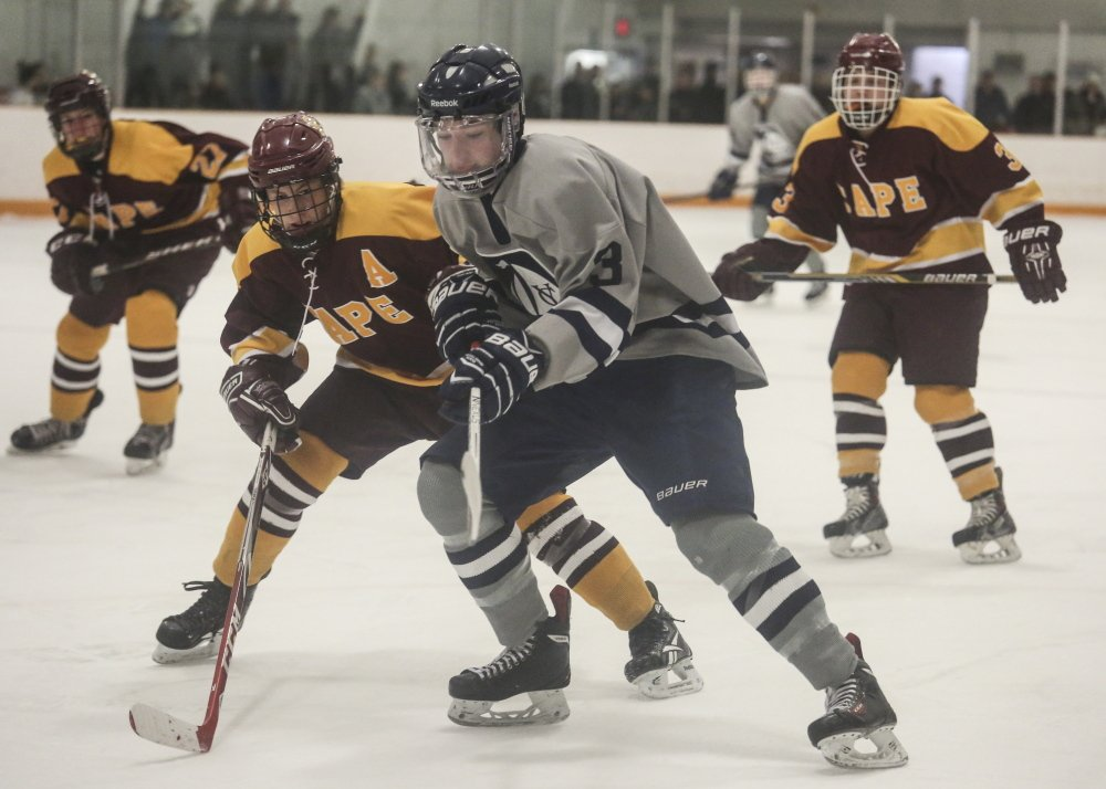 Cape Elizabeth's Eli Babcock, left, looks to steal the puck from Yarmouth's Bennett Travers as Travers tries to make his way to the goal during the Capers' 2-0 win Monday at Travis Roy Arena in Yarmouth.