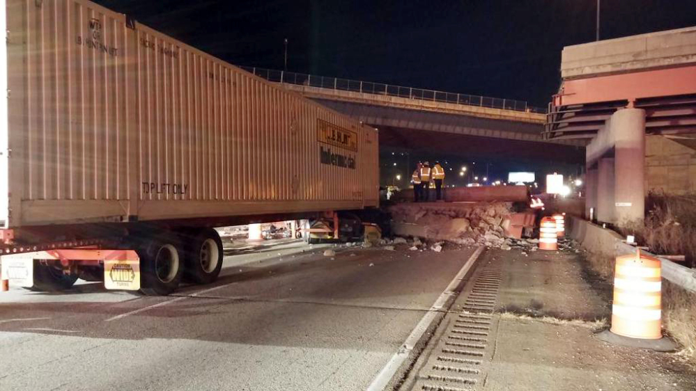 This photo provided by the Cincinnati Fire and EMS, shows the scene following a highway overpass collapse in Cincinnati, Monday.