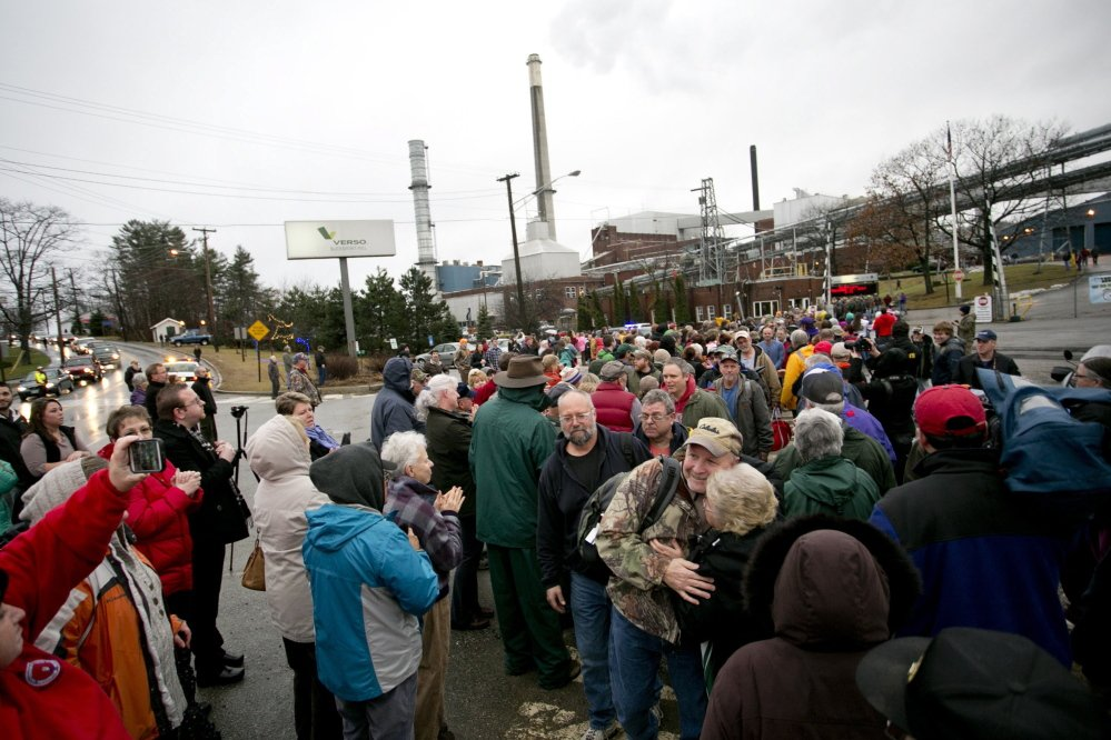 Hundreds of community members greet workers as they leave the Bucksport paper mill for the last time Dec. 17. In closing the 85-year-old mill, Verso Paper cited high energy costs and a shrinking market for the glossy paper that it produced for magazines and catalogs.