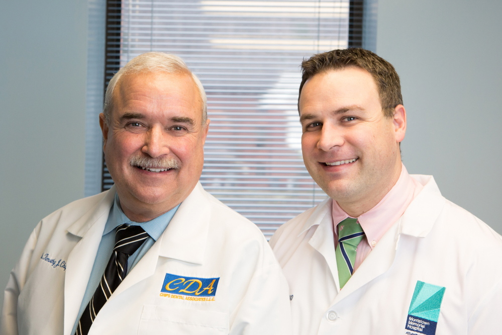 "Tim Chips, left, and his son John Chips operate a dental practice in Pennsylvania. ""We're working toward a point where he can cut back and for me to work more. A little more golf, a little less teeth,"" Tim Chips said."