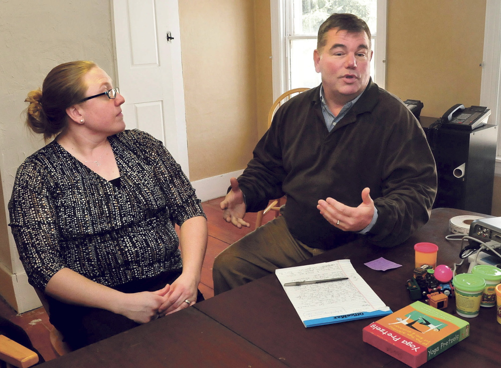 Children's Center Executive Director Jeffrey Johnson, right, speaks about the new location in Skowhegan on Tuesday as Elisa Sousa, a site supervisor, listens.
