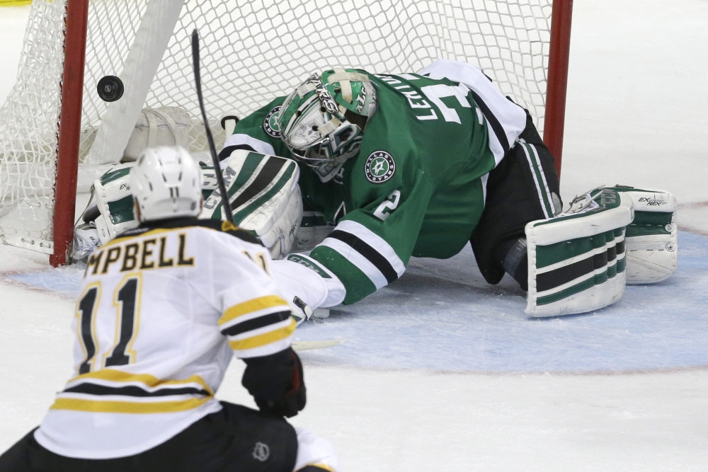 Boston Bruins center Gregory Campbell scores a goal against Dallas goalie Kari Lehtonen during the second period of Tuesday night's game in Dallas. The goal gave Boston a 2-1 lead late in the period.