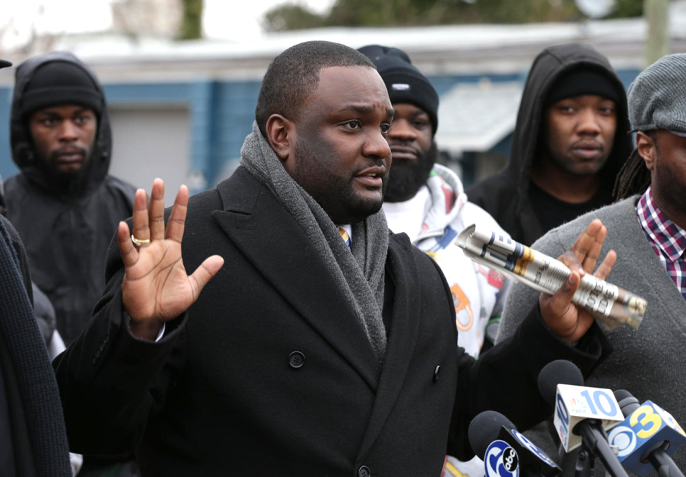 "Walter Hudson, chairman of the National Awareness Alliance civil rights group, speaks at a press conference Wednesday in Bridgeton, N.J. He said, ""The video speaks for itself that at no point was Jerame Reid a threat and he possessed no weapon on his person. ... He complied with the officer and the officer shot him."""
