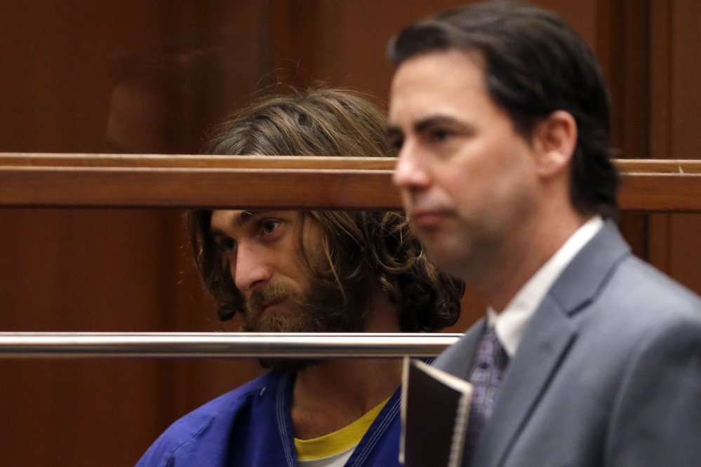 Colby Robert Kronholm, left, appears in court for his arraignment on a charge of murderiing a man in Hollywood, in Los Angeles, California, on Wednesday.
