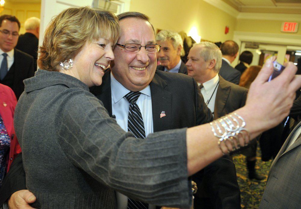 Jane Dennison takes a selfie with Gov. Paul LePage on Wednesday after he spoke to the Kennebec Valley Chamber of Commerce at the Senator Inn and Spa in Augusta.