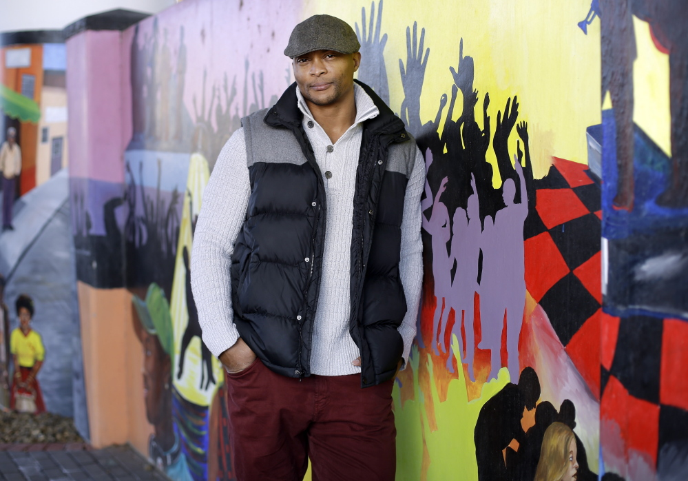 Former Tennessee Titans running back Eddie George poses at an urban improvement project designed and constructed by his landscape and design company, The Edge.