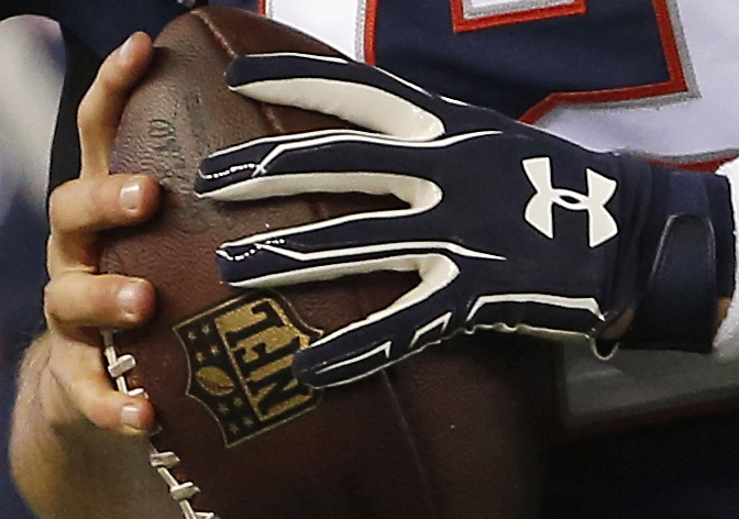 Feels good, looks good but was it legally good? And if not, who's to blame? That's Tom Brady holding a football – maybe one of those balls – during warm-ups Sunday before the AFC championship game against Indianapolis.