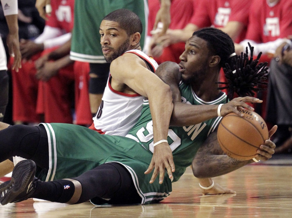Boston Celtics forward Jae Crowder battles for the ball with Portland Trail Blazers forward Nicolas Batum during the first half of Thursday night's game in Portland, Ore. The Celtics pulled out a 90-89 win in the last second.
