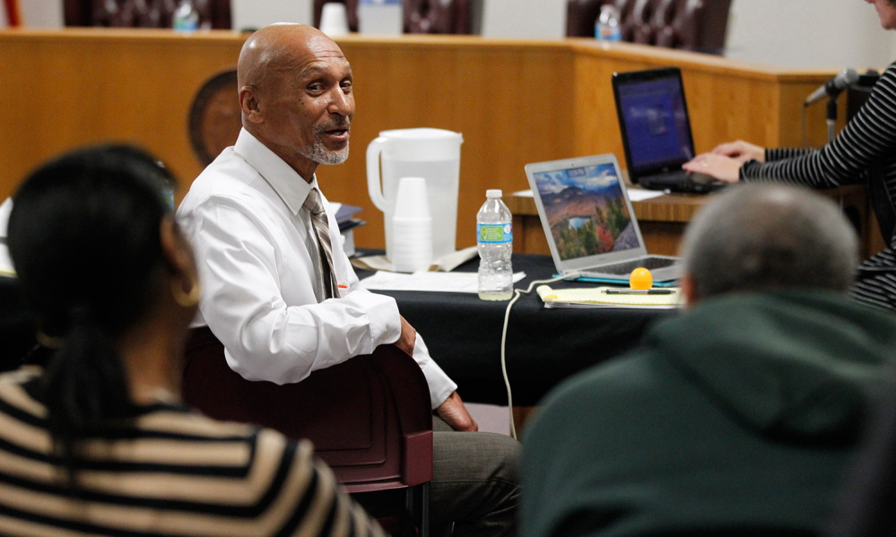 Joseph Sledge, center, talks with his sister Barbara and brother Oscar during a break as a three-judge panel takes up his claim of innocence in Whiteville, N.C., on Friday. He was exonerated after spending nearly 40 years behind bars.