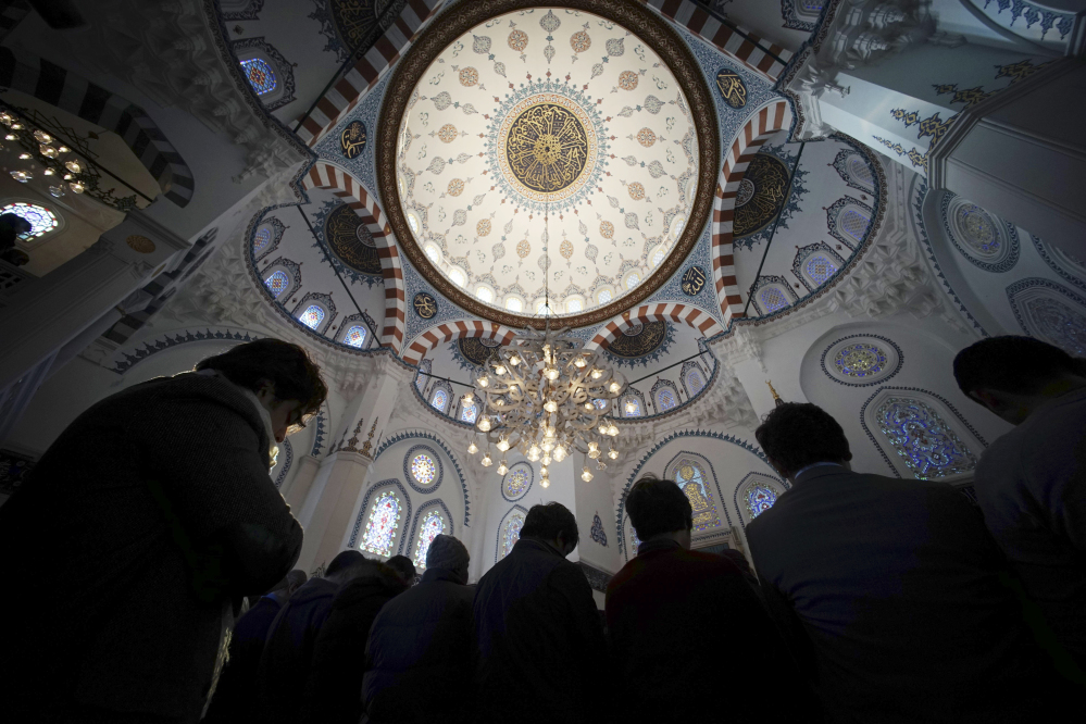 Muslims offer Friday prayers at Tokyo Camii, the largest mosque in Japan, in Tokyo, on Friday, the deadline for paying ransom for two Japanese hostages held by the Islamic State group.