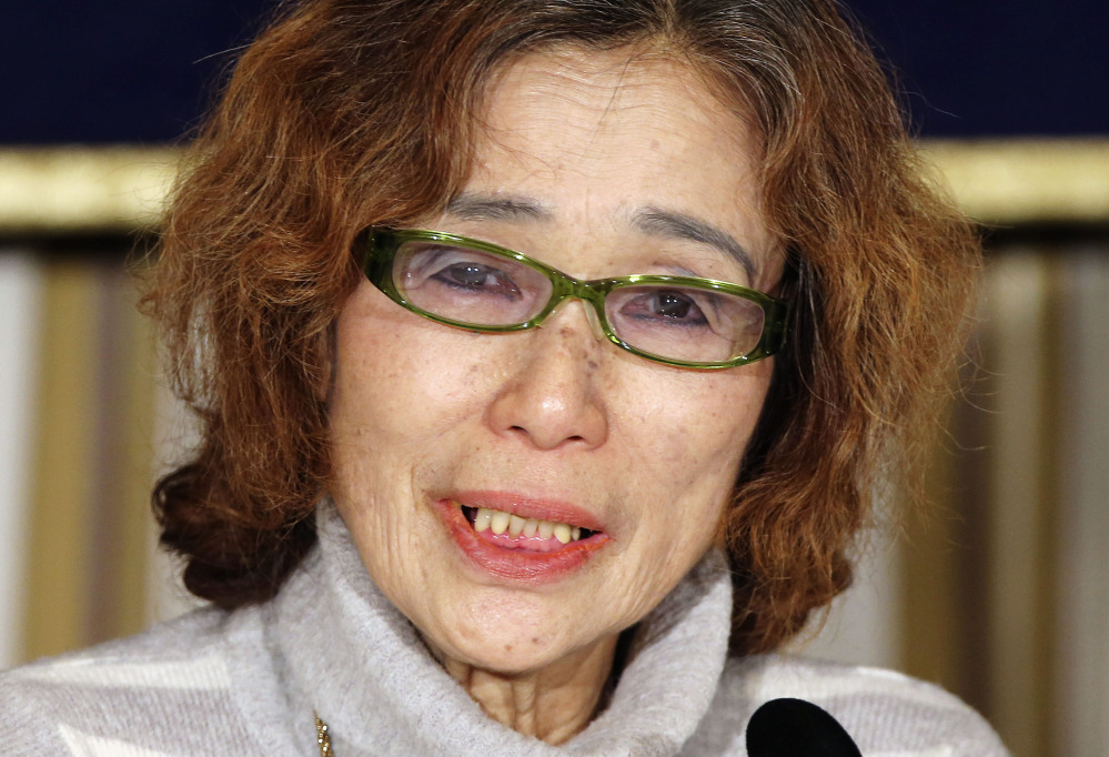 Junko Ishido, mother of Japanese journalist Kenji Goto who was taken hostage by the Islamic State group, appeals for her son's release in Tokyo on Friday.