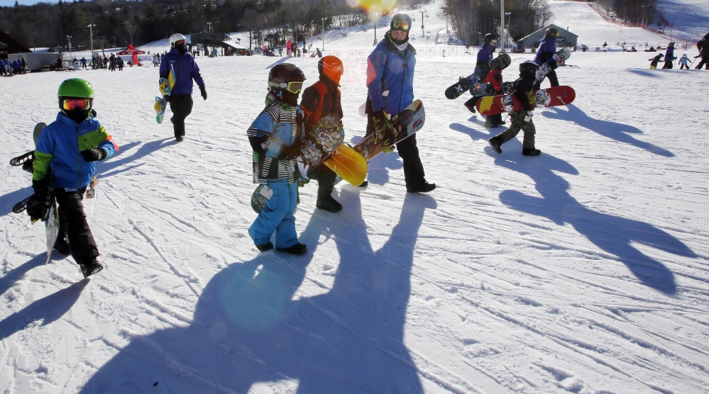 Young snowboarders head out to the slopes for lessons at Gunstock Ski area in Gilford, N.H. The popularity of snowboarding that grew at a rapid pace in the 1990s and early 2000s may have reached its peak according to the National Sporting Goods Association.