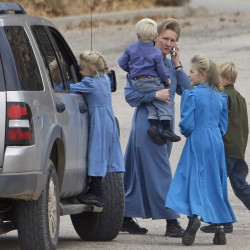 Residents walk along a street in Hildale, Utah. Some townspeople are loyal to jailed polygamist leader Warren Jeffs; others embrace government efforts to modernize the town.