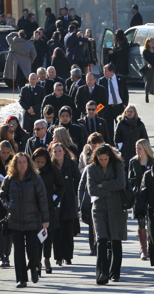 Mourners leave the funeral service for Dr. Michael Davidson on Friday at Temple Beth Elohim in Wellesley, Mass. He was shot Tuesday.