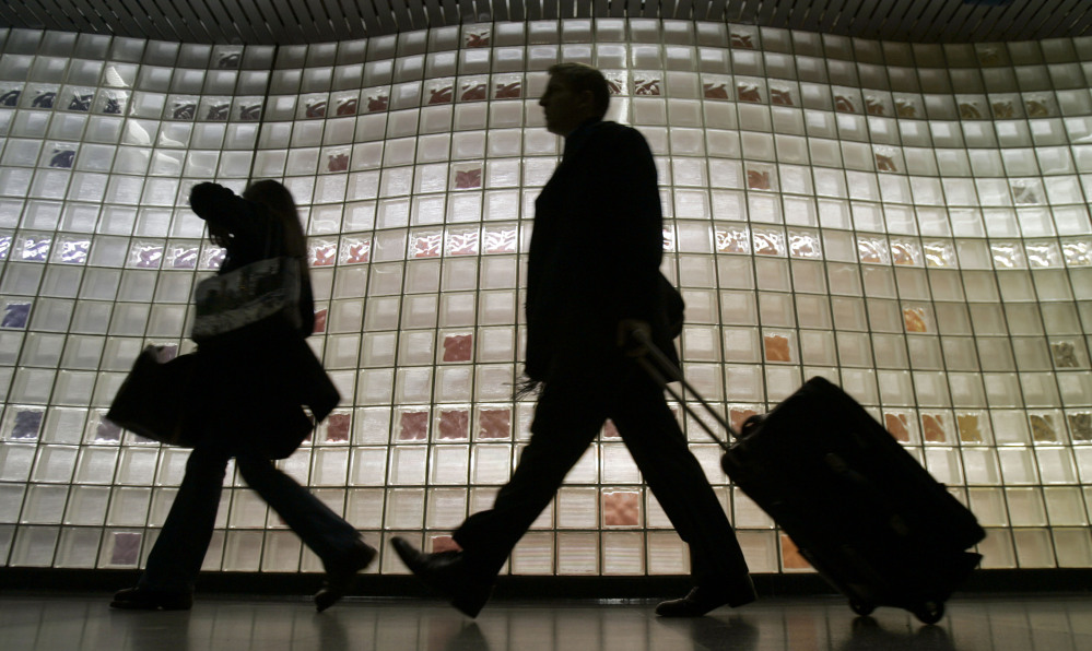 Travelers enter Chicago's O'Hare International Airport. Indebted to several airlines, the parent company of the shopping catalog SkyMall, an in-flight mainstay since 1989, filed for Chapter 11 protection in U.S. bankruptcy court this week. On Jan. 9, the catalog company took steps to pursue a possible sale.