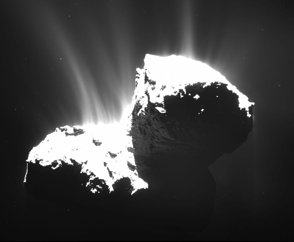 A photo taken from the Rosetta space probe 18.6 miles from Comet 67P/Churyumov-Gerasimenko in November reveals the faint jets of the comet's activity.