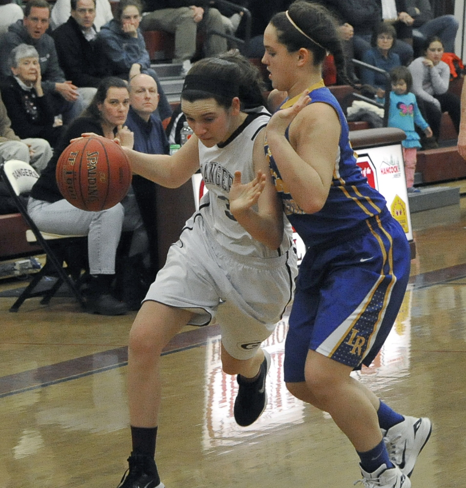 Moira Train of Greely attempts to turn the corner and head to the basket Friday night while guarded by Melody Millett of Lake Region during Greely's 52-30 victory in a Western Maine Conference game at Cumberland.