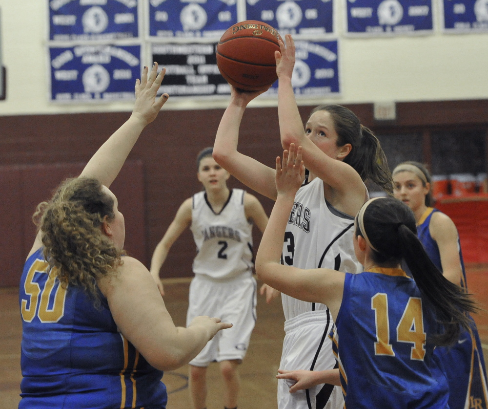Sarah Felkel, who came through with pivotal shots and rebounds for Greely, looks to shoot while guarded by Megan VanLoan, left, and Chandler True of Lake Region. Greely has a four-game winning streak while improving its record to 11-2. Lake Region is 7-6.