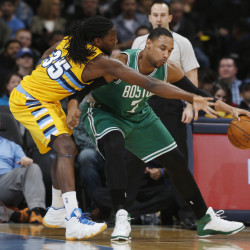 Denver Nuggets forward Kenneth Faried tries to steal the ball from Boston Celtics center Jared Sullinger, who works the ball inside for a shot in the first quarter of Friday night's game in Denver. The Celtics won their second straight game. The Associated Press
