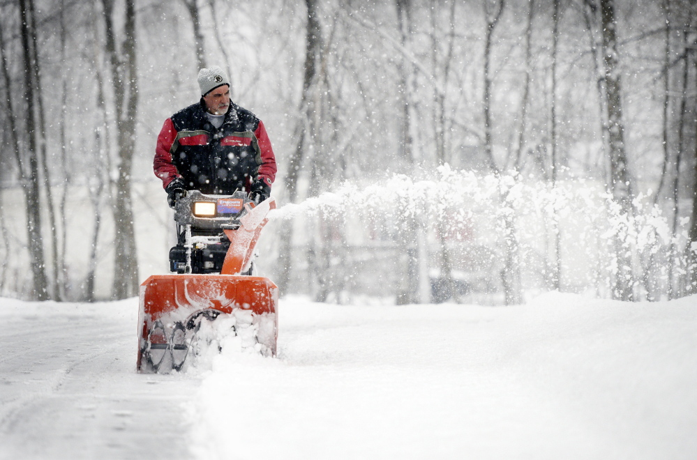 Doug Vadnais of Saco snow blows his High Street driveway during Saturday's snowfall  January 24, 2015. Patrick Ouellette/Staff Photographer