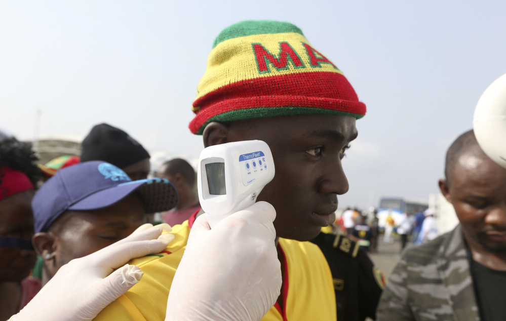 Soccer fans are checked for fever before a match last week in Malabo, Equatorial Guinea. There is still no vaccine or licensed treatment for Ebola, which has killed 8,675 people.