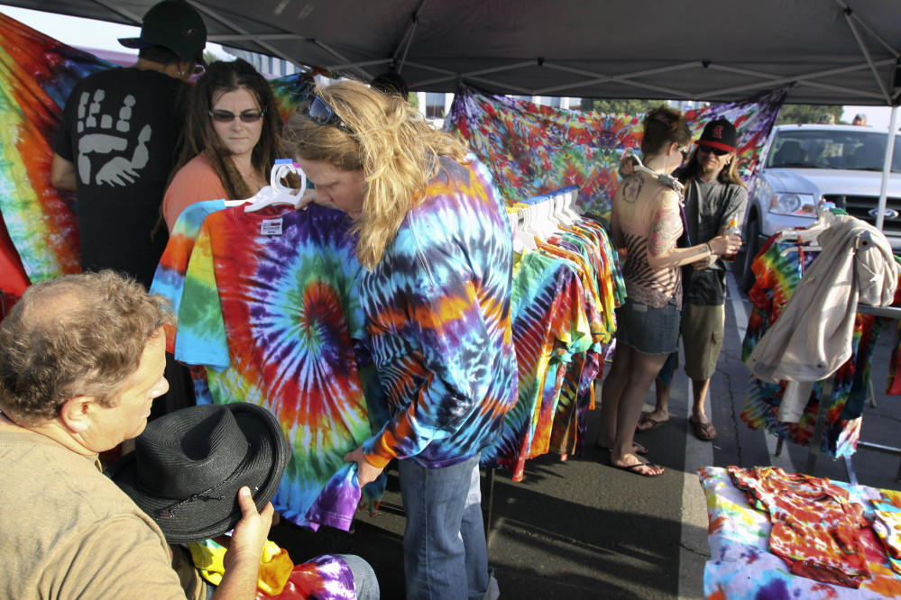 In this May 9, 2009 file photo, Grateful Dead fans shop for tie-dye T-shirts in the parking lot of the Forum before to a concert of The Dead, performing in the Inglewood section of Los Angeles.