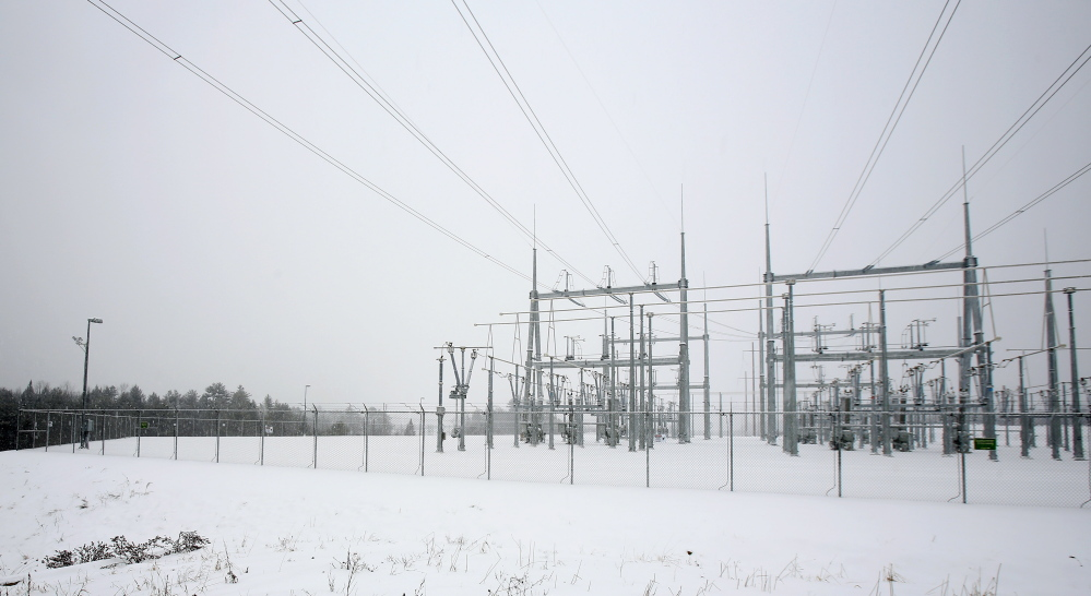 Central Maine Power's substations are monitored with security cameras, like these seen on a light post at left at the Coopers Mills substation in Windsor, which will be CMP's largest substation when it comes online. The cameras can be moved and zoomed and also use thermal imaging.