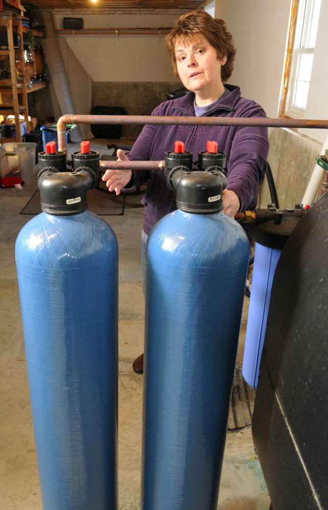 Andrea Brann of Manchester has a $3,300 water filtration system. Arsenic in well water can be a problem in parts of central and Down East Maine.