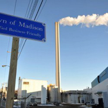 The Madison Paper Industries mill in Maine faces stiff competition from a mill in Canada that officials claim is unfairly subsidized.