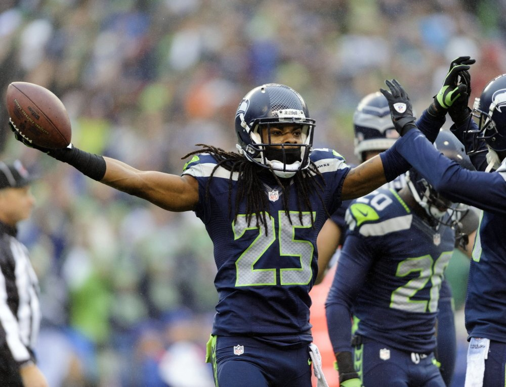 """""""Just another week,"""" is how Seattle cornerback Richard Sherman described last year's run-up to the Super Bowl, which the Seahawks won in convincing fashion. But this year there's precious little talk about football itself as off-field distractions threaten to make a sideshow out of the big game itself."""