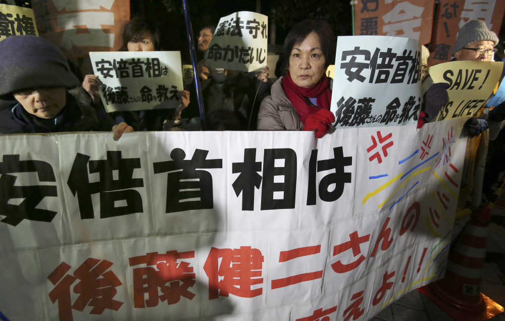 "Protesters rally with signs and a banner reading: ""Prime Minister Abe, save the life of Kenji Goto!"" in front of Prime Minister Shinzo Abe's official residence in Tokyo on Sunday."