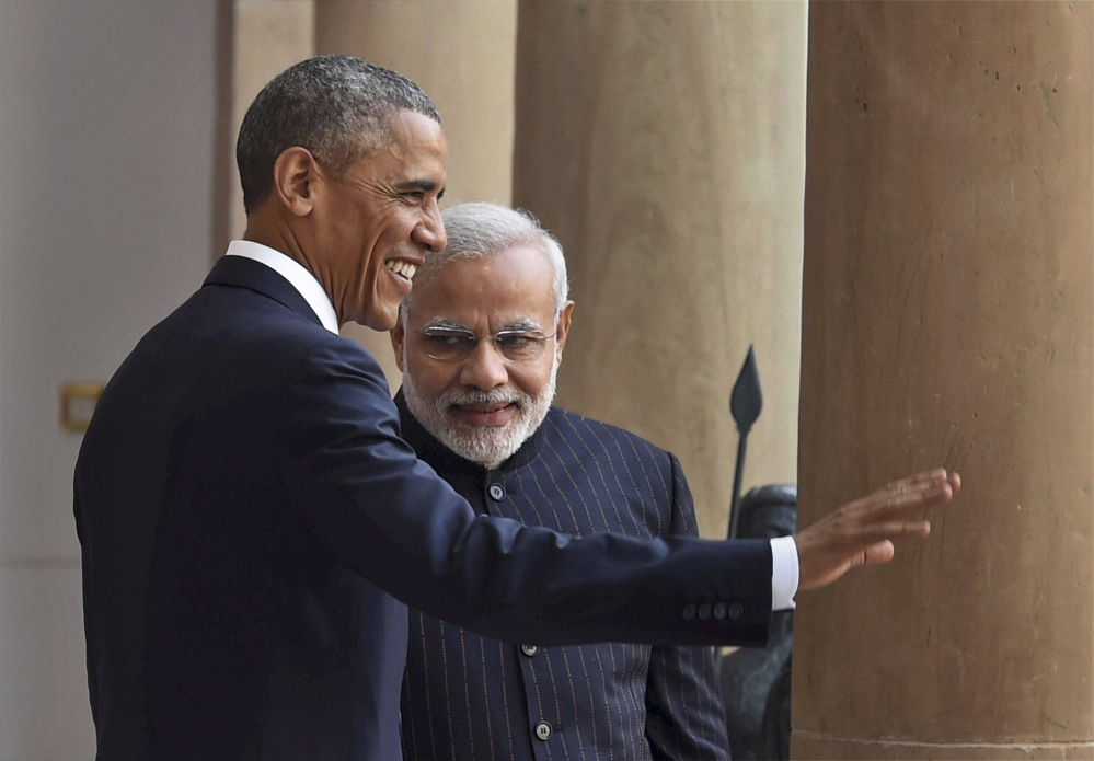 "U.S. President Barack Obama, left, and Indian Prime Minister Narendra Modi pose for the media before holding their talks, in New Delhi, India, on Sunday. Seizing on their personal bond, Obama and Modi said Sunday they had made progress on nuclear cooperation and climate change, with Obama declaring a ""breakthrough understanding"" in efforts to free U.S. investment in nuclear energy development in India."