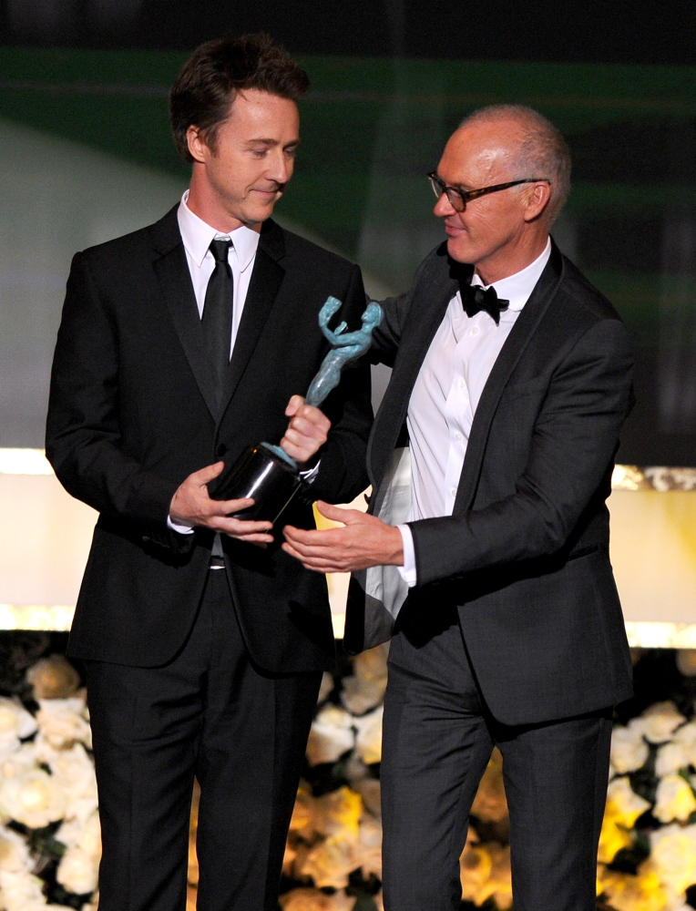 "Edward Norton, left, and Michael Keaton accept the award for outstanding performance by a cast for ""Birdman"" at Sunday's Screen Actors Guild Awards."