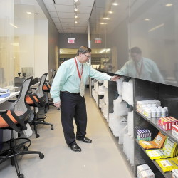 William Hewitt organizes the front end of the state's first 24-hour pharmacy at Maine Medical Center before Monday's official opening.