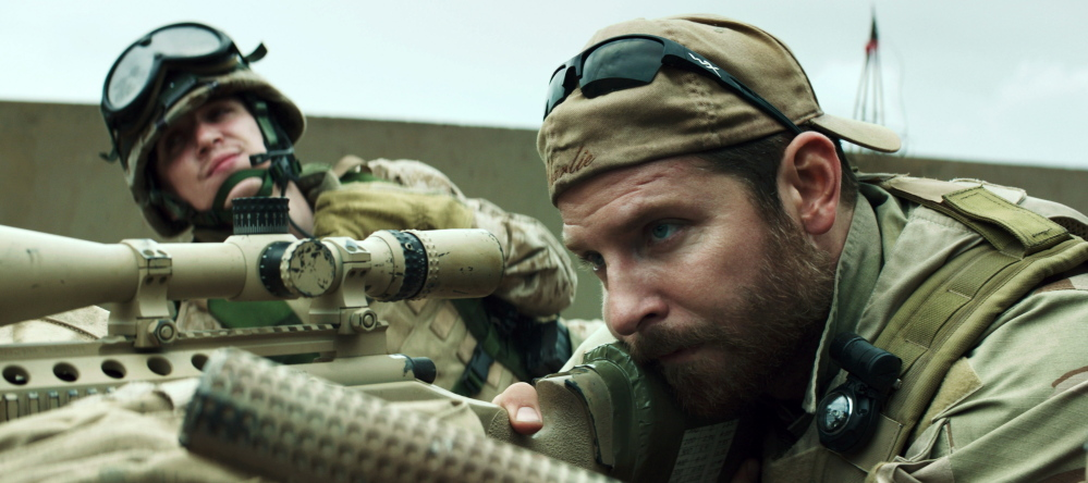 "Kyle Gallner, left, and Bradley Cooper appear in a scene from ""American Sniper."""