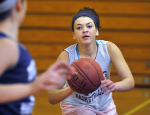 "After serving as Deering's primary point guard during her freshman season, Tasia Titherington is now playing a more diversified role. ""I think not being a point guard all the time actually helps me,"" said Titherington."