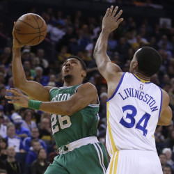 Boston's Phil Pressey shoots over Golden State's Shaun Livingston during the Warriors' 114-111 win over the Celtics on Sunday in Oakland, Calif. Golden State has an NBA-best record of 36-6.