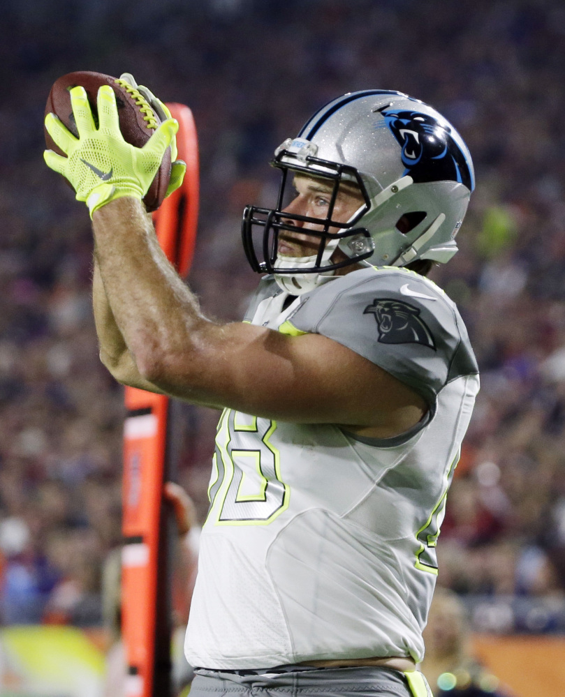 Carolina's Greg Olsen catches a touchdown pass for Team Carter during the first half of the Pro Bowl in Glendale, Arizona. Team Irvin won the fun-filled affair, 32-28.