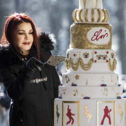 Priscilla Presley cuts the eight-tiered birthday cake during the 80th birthday celebration for her late ex-husband, Elvis Presley, on Jan. 8 at Graceland in Memphis, Tenn.