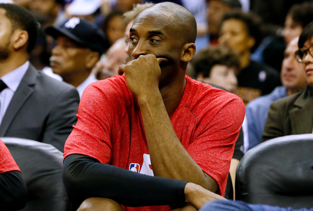 Los Angeles Lakers guard Kobe Bryant sits on the bench during Wednesday's game in New Orleans. Bryant tore his right rotator cuff in the game and will likely miss the rest of this season after having surgery this week.