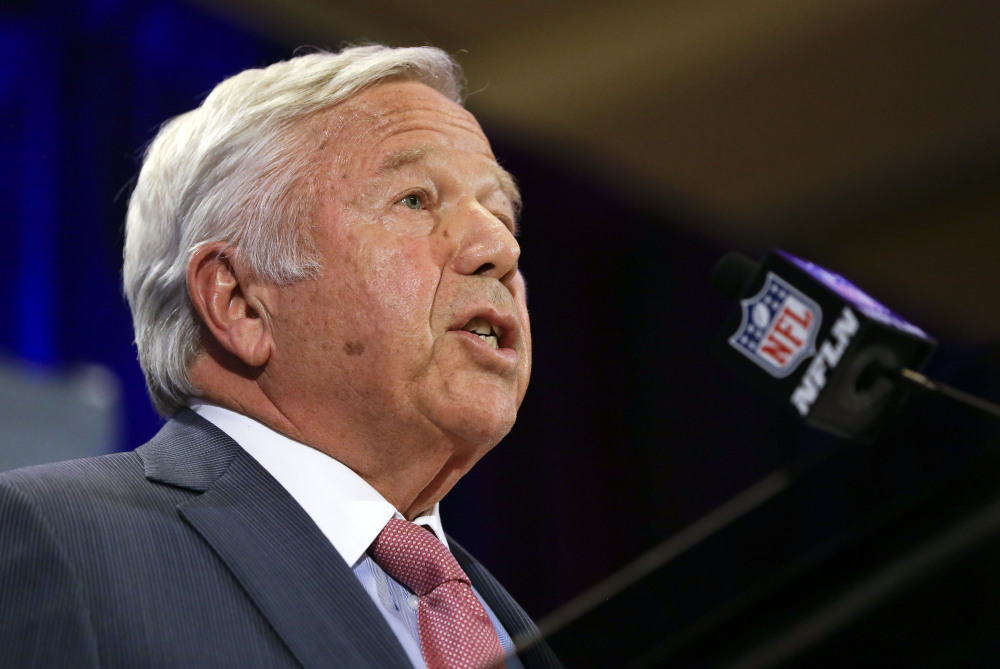 """New England Patriots owner Robert Kraft speaks during a news conference Monday in Chandler, Ariz. He said that if the NFL """"is not able to definitively determine that our organization tampered with the air pressure in the footballs, I would expect and hope the league would apologize to our entire team."""""""