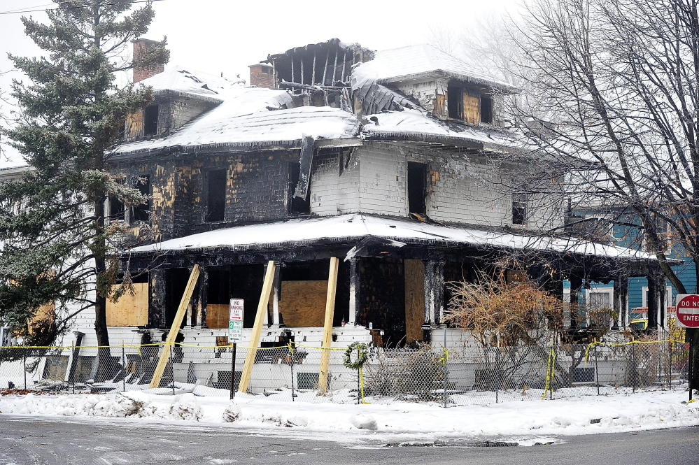 The three-story, two-unit apartment building at 20-24 Noyes St. in Portland, where a fire on Nov. 1 killed six young adults.