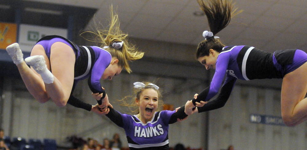 Marshwood High School cheerleaders perform a stunt during the Western A cheerleading championships Monday.  Andy Molloy/Kennebec Journal