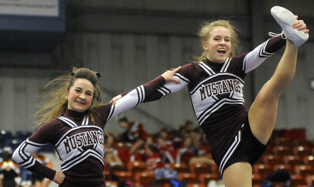 Monmouth Academy performs its routine during the Western C championships Monday at the Augusta Civic Center. Andy Molloy /Kennebec Journal