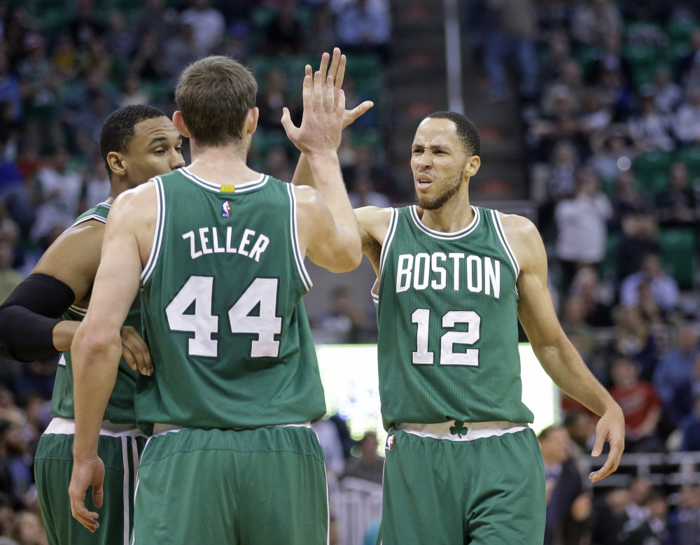 Celtics newcomer Tayshaun Prince (12) high-fives Tyler Zeller in the fourth quarter of Monday night's game in Salt Lake City. The Celtics won, 99-90, as Prince scored 19 points.