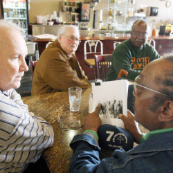 In this Jan. 23, 2009, file photo, Elwin Wilson, left, and Friendship 9 member Willie McCleod, right, look over pictures from civil rights incidents in Rock Hill, S.C., in the 1960s.