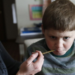 Nicole Gross gives son Chase a medical cannabis oil. The family moved from Chicago to Colorado to legally treat Chase, who used to have multiple seizures daily.