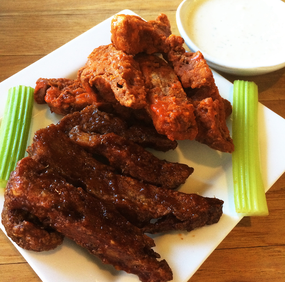 Seitan wings and sauce is a favorite Super Bowl recipe at the South Portland home of photographer Patrick Jones.